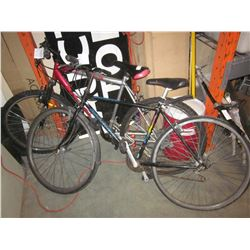 RED AND GREY SUPERCYCLE BIKE AND BLACK RALEIGH BIKE