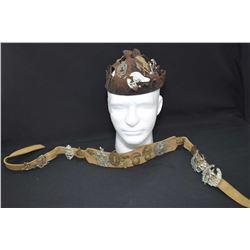 Hat and strap covered in vintage metals and badges including WWI Gordon Highlander Regiment, WWI kin
