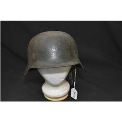 Vintage German military helmet with handwritten soldiers name inside