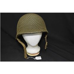 Military helmet with inner liner and outer netting
