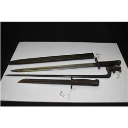 Three vintage rifle bayonets including WWI American with scabbard