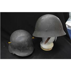 Two vintage military helmets including one with German Eagle Swastika litho