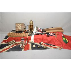 Selection of collectibles including simulated trench art shell, torch, compass, flags, bottle opener