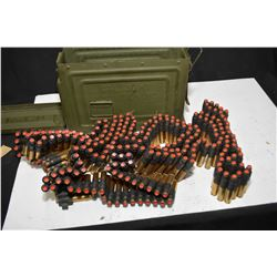 Metal ammunition can with a full loaded belt containing blank cartridges