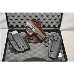 Foam lined medium sized pistol case with three 1911 holsters, two polymer and one leather