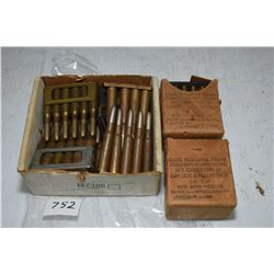 Selection of vintage military ammunition on stripper clips including two full 1 18 count boxes of 7.