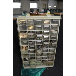Plastic multi-drawer cabinet containing sling mounts, sights, hardware, safeties etc.