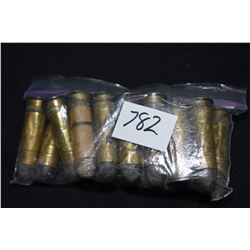Fifteen loose round unmarked large calibre center fire rounds, possibly Snider