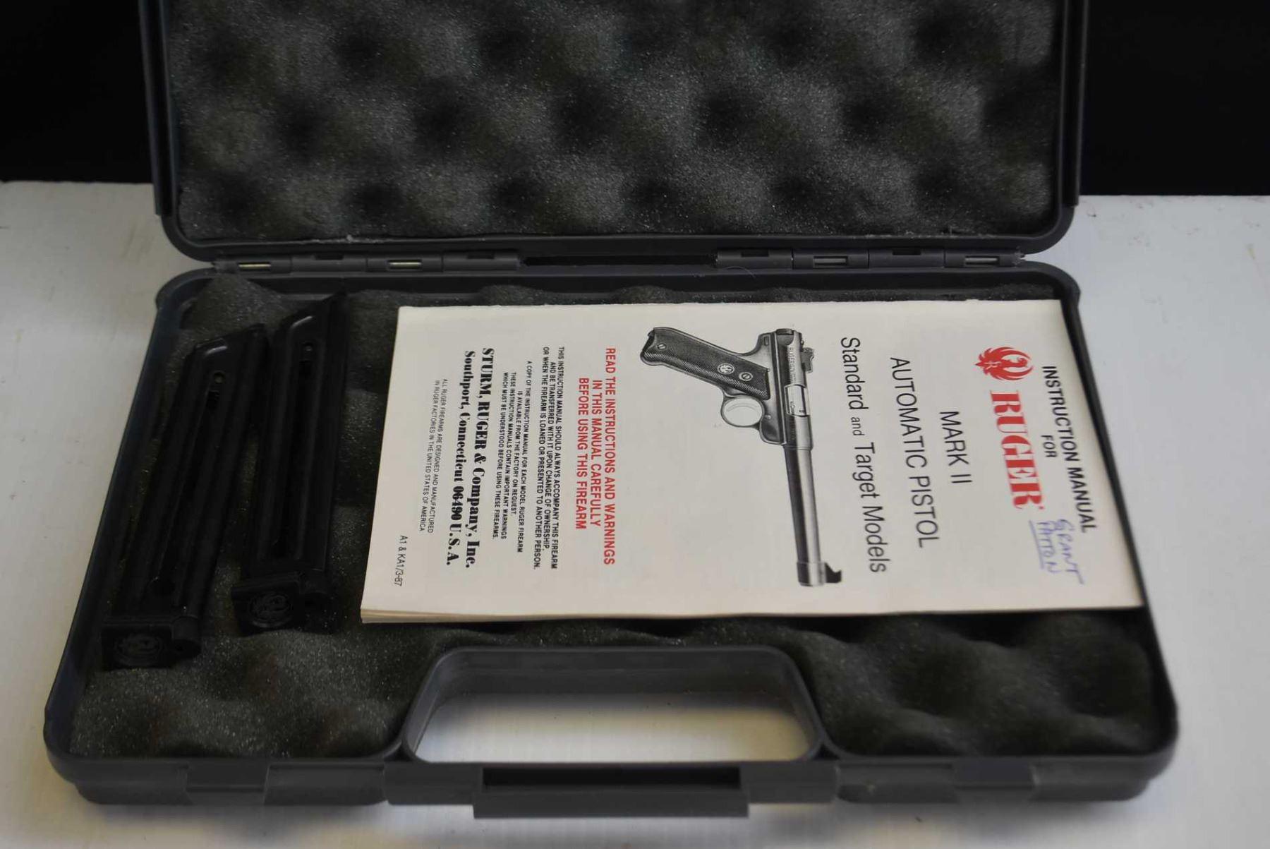 Foam lined hard pistol case with Ruger MK II owner's manual