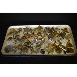 Large selection of hat and lapel badges, appears to be mostly original, some reproductions may be in