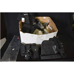 Miscellaneous box containing new and used items including belt loops, ammo. bands, flashlight pouche