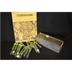 Fourteen trail size vials and a book on applying camouflage make-up