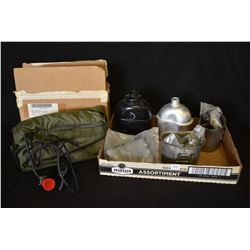 Selection of new and surplus items including masks, filters, canteens and a rations heater