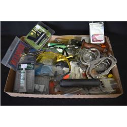 Large selection of surplus new and used items including wrist clamps, safety glasses, handcuff keys,