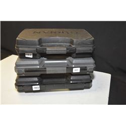 Three hard plastic pistol cases