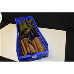 Selection of surplus spike bayonets, cleaning kits and brushes