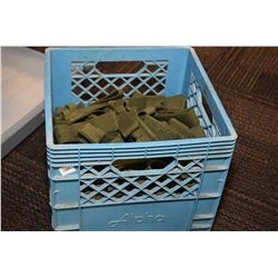 Milk crate filled with webbed bayonet holsters