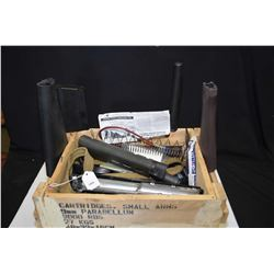 Wooden box with assorted parts including mags, stocks, forend, shotgun tube extension etc.