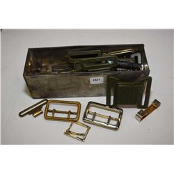 Small metal box with an assortment of buckles including metal, brass and plastic