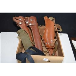 Two long barreled leather hip holsters and a leather shoulder holster