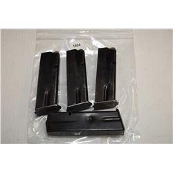 Four metal pistol mags