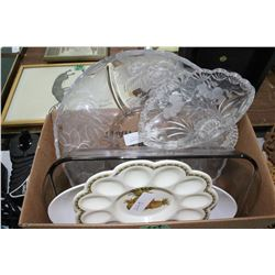 Box of Assorted Dishes and a Tablecloth