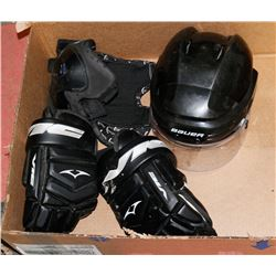 BOX OF USED YOUTH HOCKEY EQUIPMENT