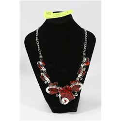 DECORATIVE SILVER TONED NECKLACE WITH RED GEM