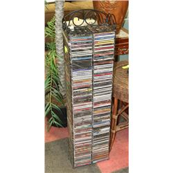 CD RACK WITH OVER 180 CDS.