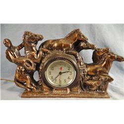 """Brass Rodeo cowboy w/5 horses and calf elec clock, 10"""" h x 17"""" w"""