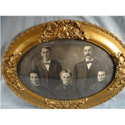 "Antique oval picture frame with curved glass, 13"" h x 19"" w"