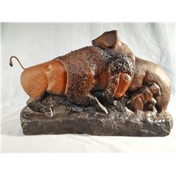 "Chopwood,  Hank sandstone carving, Buffalo Bull Attacking Mama Bear and Cub, 18"" w x 11"" h"