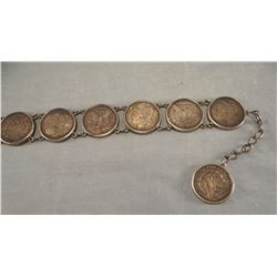 "Morgan dollar belt, 17 coins, 33"" long"