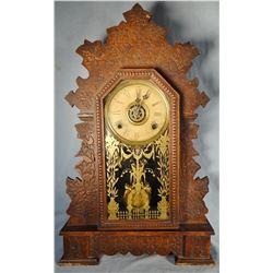 """Walnut ginger bread clock, ca. 1890's, 24"""" h"""