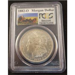 2 Morgan dollars, 1882, NGC AU 58 and 1882 O, PCGS BU