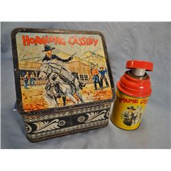Hop Along Cassidy memorabilia including 4 picture puzzles, lunch box w/thermos, napkin, wallet, book