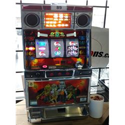 TAKASAGO MONSTER THEMED TABLE-TOP SLOT MACHINE WITH TUB OF TOKENS