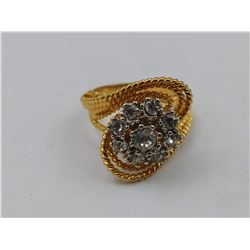 GOLD COLORED RING WITH 9 CZ STONES