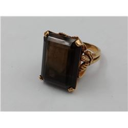 GOLD COLORED RING WITH LARGE SMOKEY BROWN STONE