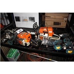SHELF OF ASSORTED POWER TOOLS INCLUDING CHAINSAWS DRILLS AND MORE