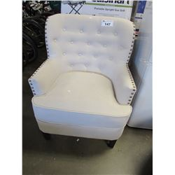 BEIGE STUDDED WING BACK CHAIR