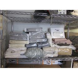 LARGE SHELF LOT OF ASSORTED LINEN (BED SHEETS, CURTAIN PANELS, ETC)