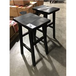 PAIR OF BLACK WOODEN STOOLS