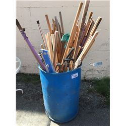 BLUE PLASTIC BARREL FILLED WITH ASSTD DOWELS, GOLF CLUBS & MISC. ITEMS
