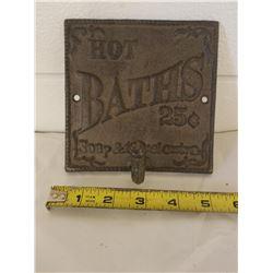 CAST IRON TOWEL RACK (HOT BATHS 25¢)