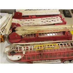 LOT OF 4 NYLINT FIRE TRUCKS (W/O CABS) *EXTRA PARTS*