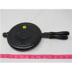 CAST IRON WAFFLE MAKER (TAYLOR FORBES) & IRON REST