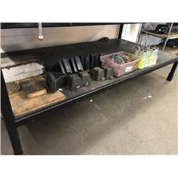 CONTENTS OF BOTTLE SHELF OF BENCH INC. WHEEL CHOCKS, COOLANT FLUSH AND MORE