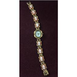 Elegant Ladies Gold Tone Quartz Watch with Unique Band