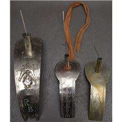 THREE DECORATIVE ROACH SPREADERS
